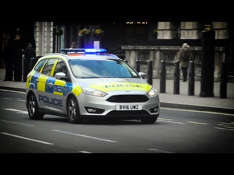 London Metropolitan Police cars responding on lights and sirens