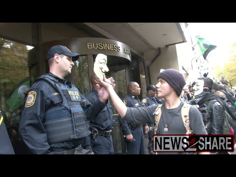 Protesters Clash with FBI in Million Mask March 2014