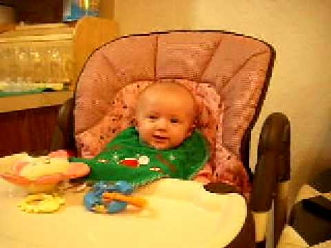 Baby Girl in Highchair for the first time