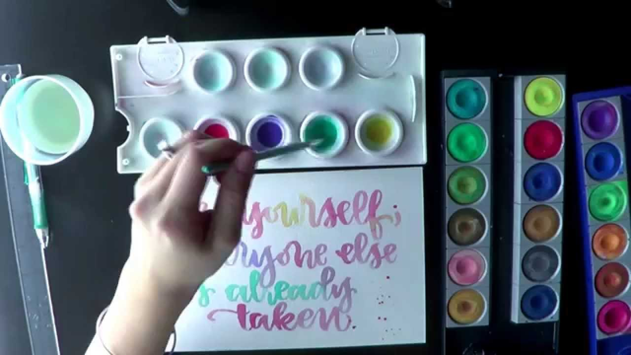 Watch me write brush calligraphy and lettering with watercolor