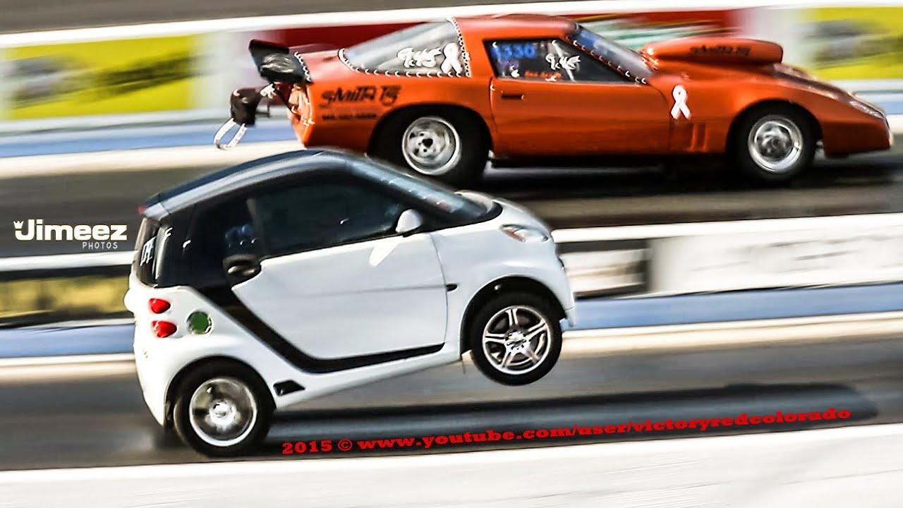 wheelstanding smart car takes on drag vette youtube