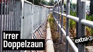 Realer Irrsinn: Doppelt eingezäuntes Geländer in Düsseldorf