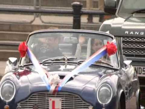Prince William and Kate Middleton driving away from the reception in an Aston Martin