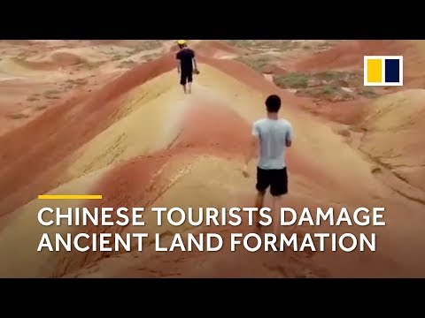 Chinese tourists damage ancient land formation
