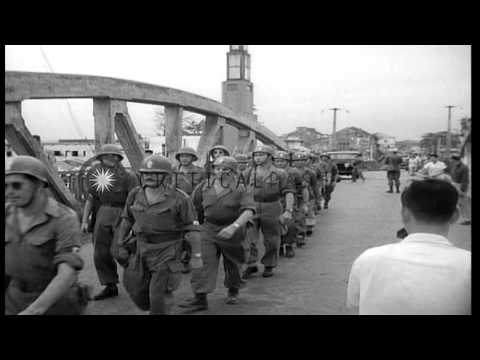Communist troops at bridge over Haney Canal in Haiphong, Vietnam. HD Stock Footage
