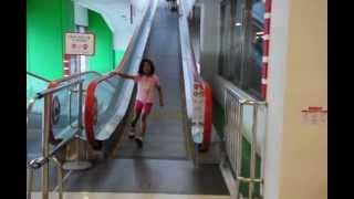 Yun Jung proficient riding Heelys down escalator