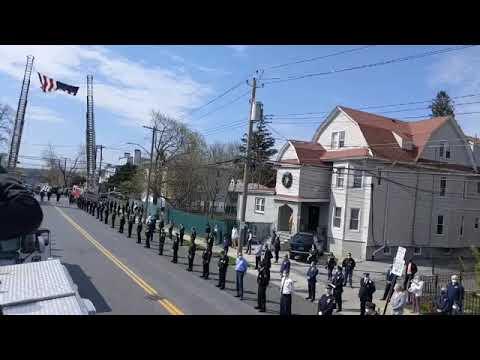 The escort for Yonkers Police Det. William Sullivan.