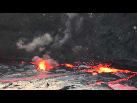 Drum of water into Erta Ale lava lake