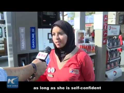 Egypt gas station girls prove confident in male-dominant career