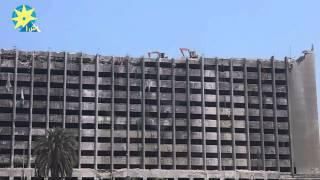 بالفيديو البلدوزرات أعلى سطح مبنى الحزب الوطنى المنحل وحولها العلم الوطنى