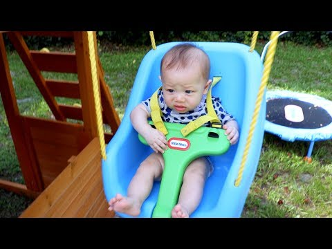 BABY'S REACTION: FIRST TIME ON A SWING!