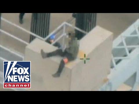 Shocking video: New York police save suicidal man on top of bridge