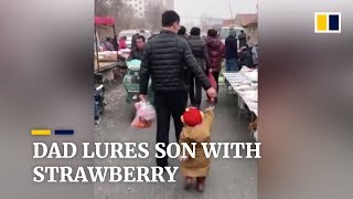 Smart father uses strawberry to lead son through market