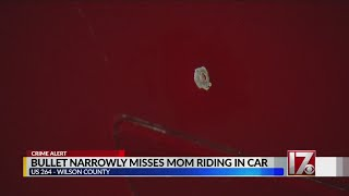 Bullets narrowly miss mom riding in car on HWY 264