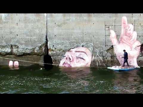 Artist Creates Massive Wall Mural Using Bay Of Fundy Tides