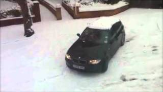 bmw 1 series in snow women driver leaves in gear and crashes