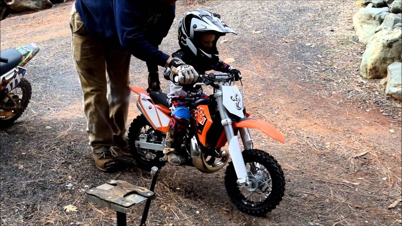 ktm 50 SX Mini For Christmas!?! 2 years old riding the KTM for the First  time!