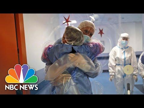 Plastic Hug Wall Brings Joy To Italian Covid Patients   NBC News NOW
