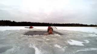 Winter swimming - ice hole sit in Latvia for 11 min