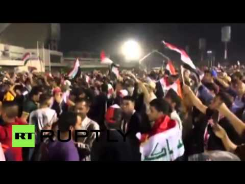 Iraq: Anti-govt. protesters celebrate after storming Baghdad parliament