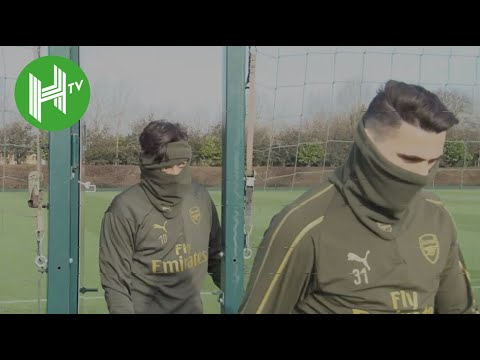 Mesut Ozil sports double snood as Arsenal train ahead of clash with BATE Borisov