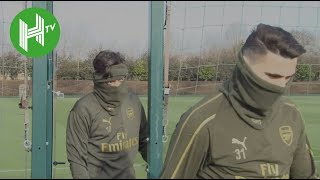 Mesut Ozil sports double snood as Arsenal train ahead of clash with BATE Borisov
