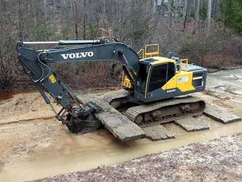 Excavator Venturing Out Onto Quicksand
