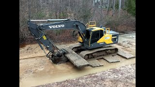 Excavator Venturing Out Onto Quicksand