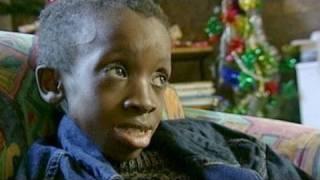 Gail Johnson Honors Adopted Son Nkosi