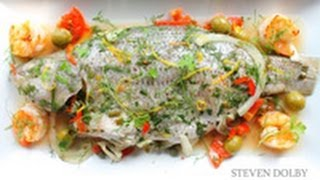 Striped Bass Stuffed With Fennel, Lemon, Tomatoes, Olives & Capers