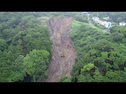 Japan landslide: 80 missing as rescuers race against time to comb through mud