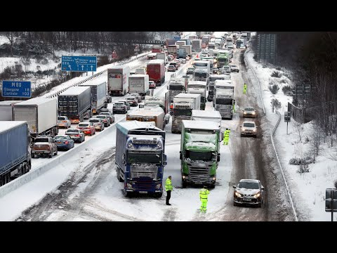 Red alerts announced as snow causes disruption across UK