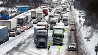 Parts of the UK are on red alert as snow continues to fall across m...