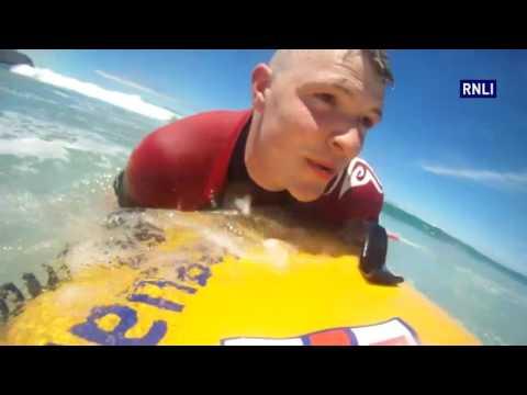 Perranporth Lifeguards Pick Up Bodyboarder Using Rescue Board