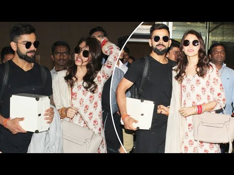 Anushka Sharma And Virat Kohli At Mumbai Airport For Grand Wedding Reception
