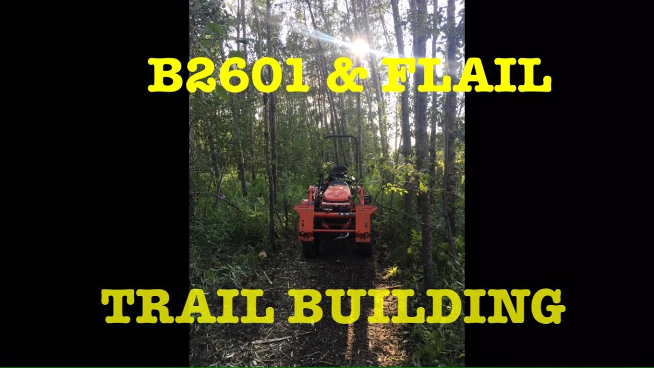 Kubota B2601 and Flail mower out building trails in the woods