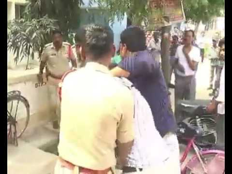 Inhuman Indian Police brutality caught on camera. Beat a common man with stick, waiting in queue!!