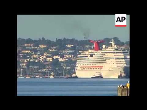 Six tug boats pulled a stricken cruise ship to San Diego Bay early Thursday, bringing the nearly 4,5