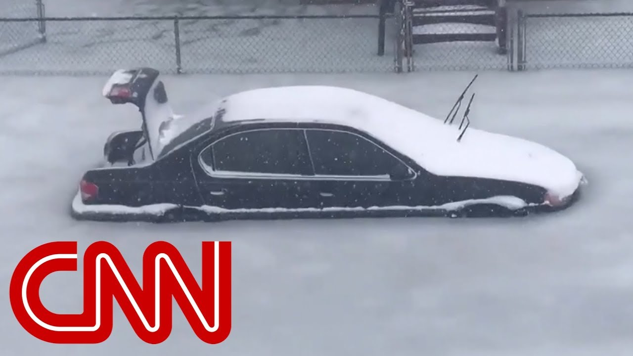 Cars trapped in frozen flood