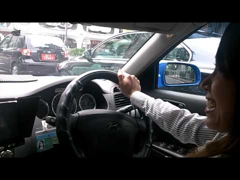 Woman Taxi Driver in Singapore