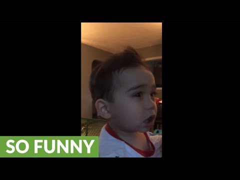 Baby has mind blown by AC unit