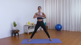 Flexible Indian girl in sportswear effortlessly doing side stretches on a yoga mat