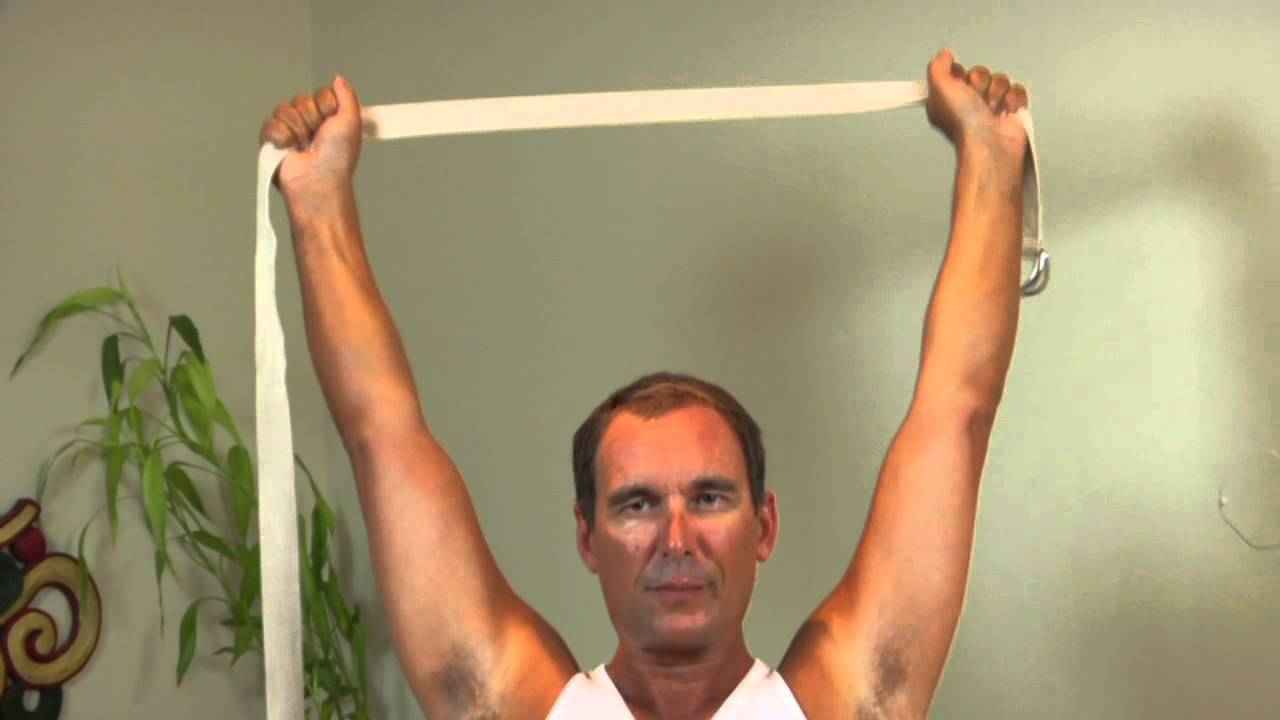 How to Use a Yoga Strap to Straighten the Shoulders   Back   Yoga ... f3195bc9837d