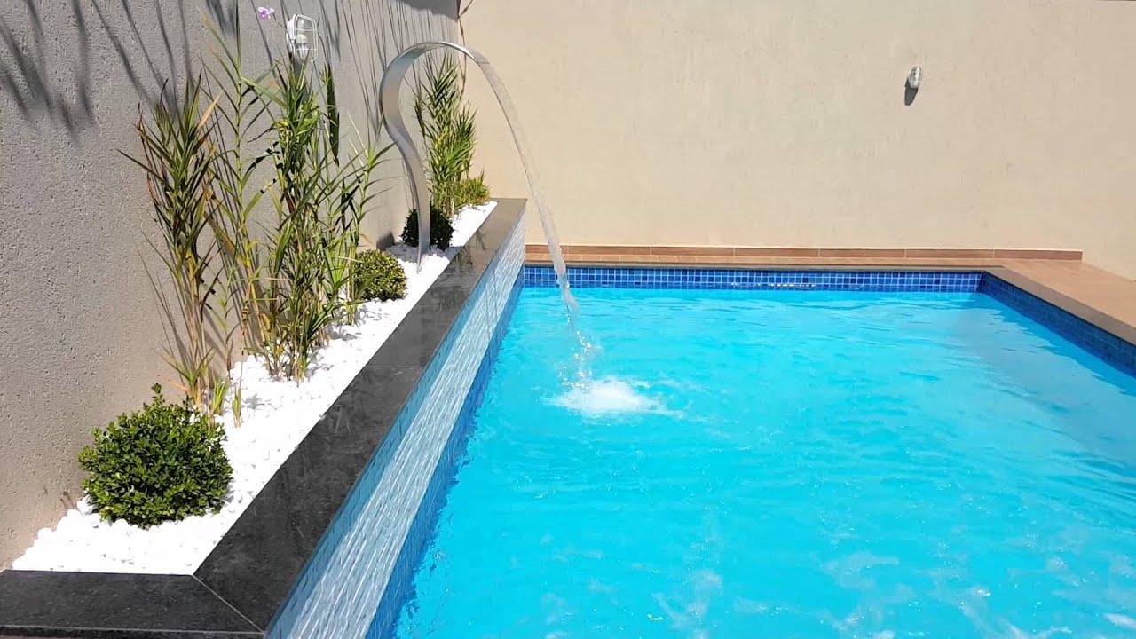 piscina constru da em alvenaria revestida em fibra com