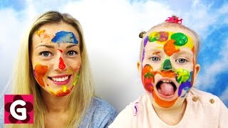 Gaby and Mommy painting faces with Body Paint