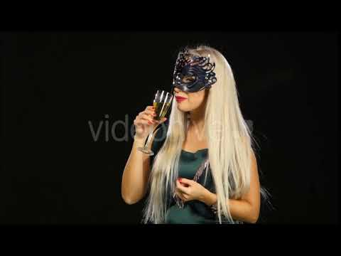 Woman with Glass of Champagne Wearing Venetian Masquerade Mask at Party, on Black | Stock Footage -