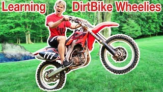 TEACHING ME TO DIRTBIKE WHEELIE!!