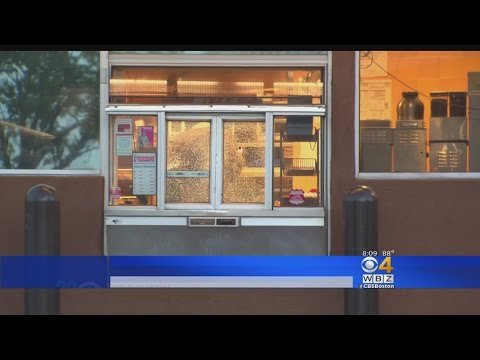 A Dunkin Donuts Drive-Through Window Shot Over A Sandwich