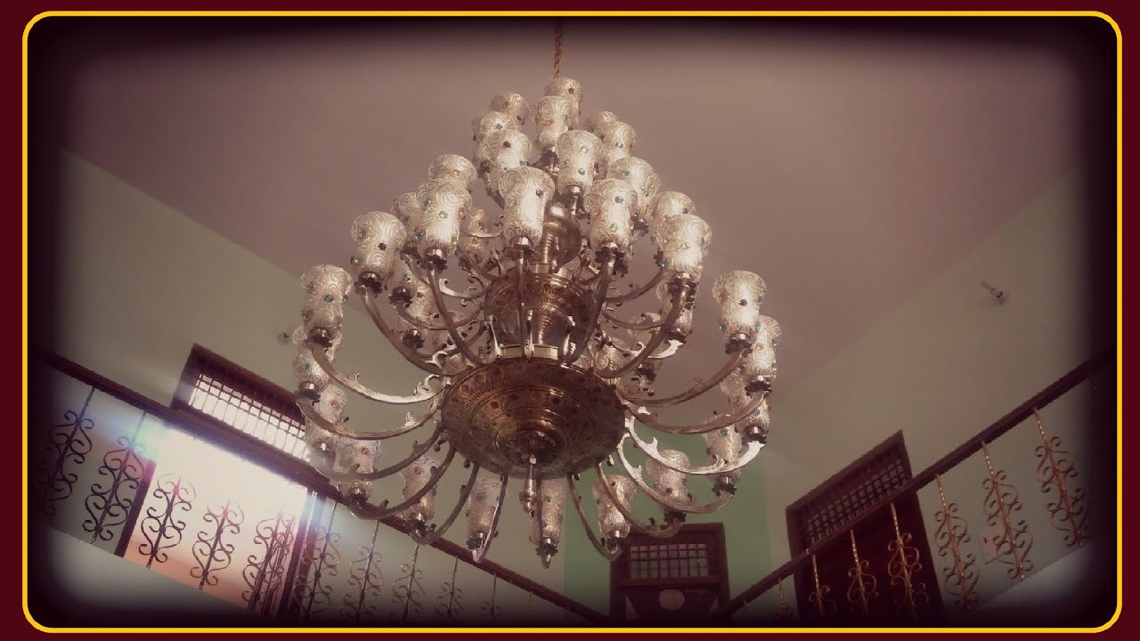 Home decor.  Jhumar installation.  22 feet Chandelier installation.  best  jhumar