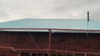 Самодельная конструкция для сбора дождевой воды.